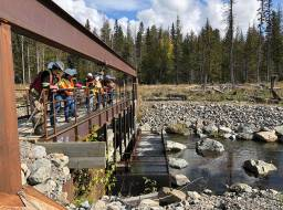 Polley Lake weir with view of fish ladder, and  SD27 school teacher tour group (partnership initiative with MineralsEd)--Sep 2019