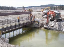 Polley Lake weir, water control structure, under construction at outlet of Polley Lake--Apr 2015